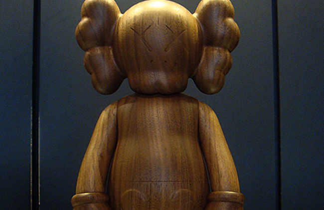 kaws-original-fake-karimoku-wood-companion-toy-1